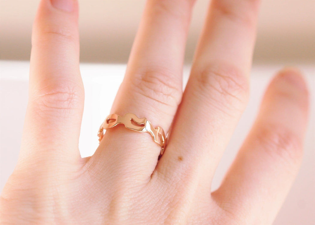 rose gold monstera ring on hand 2