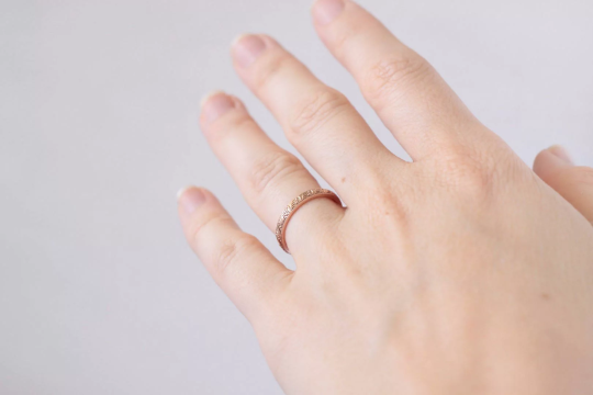 rose gold patterned ring on hand
