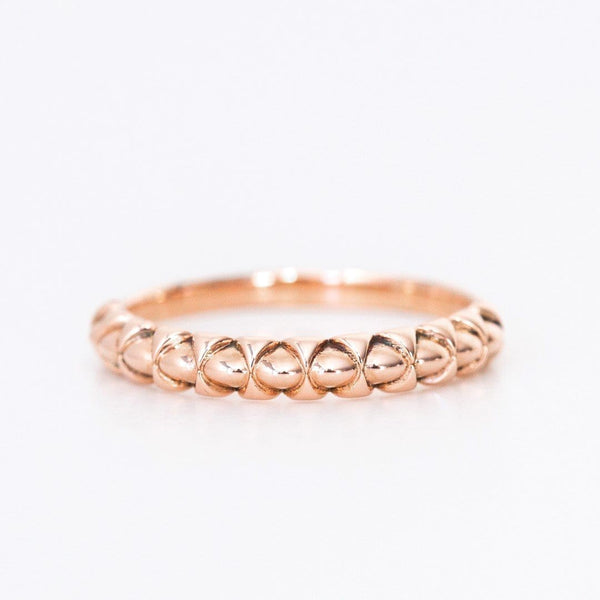 rose gold unique nepalese inspired ring on white background