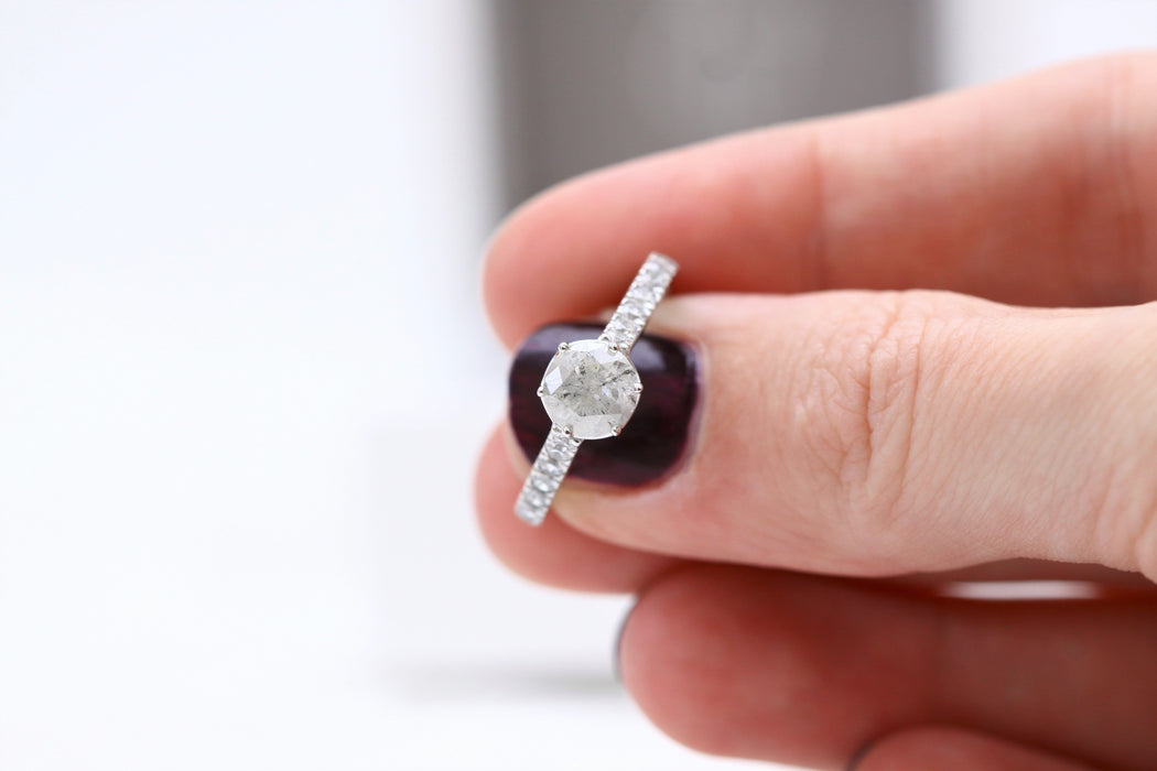 salt and pepper diamond ring between fingers