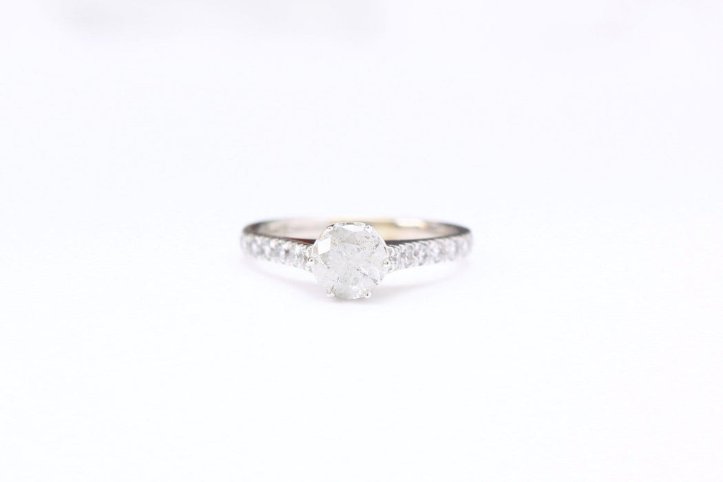 salt and pepper diamond ring on white background