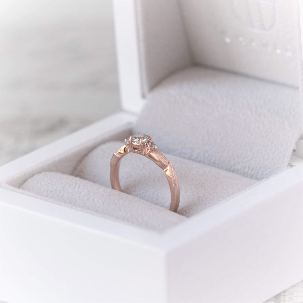 three diamond leaf engagement ring in rose gold