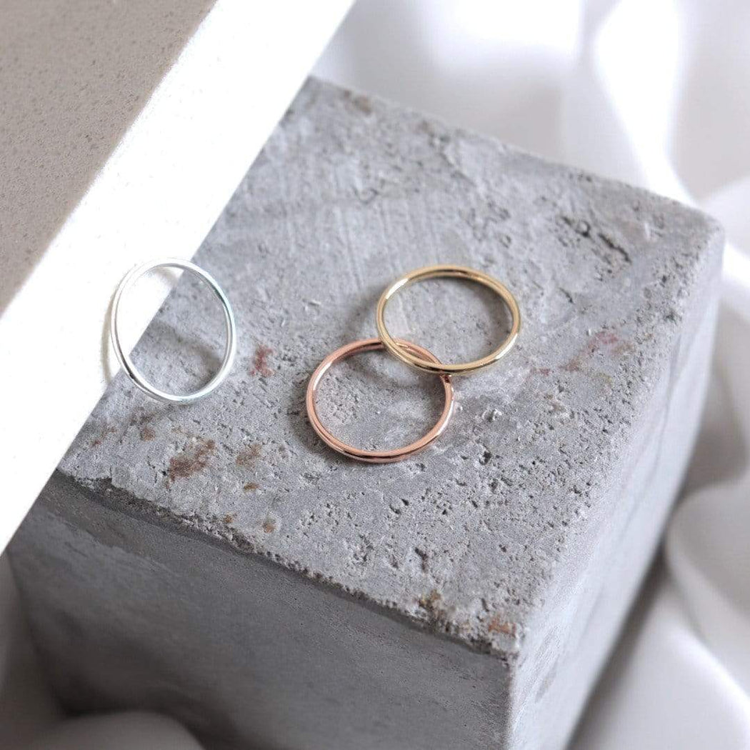 yellow white and rose gold stacking wedding rings on granite
