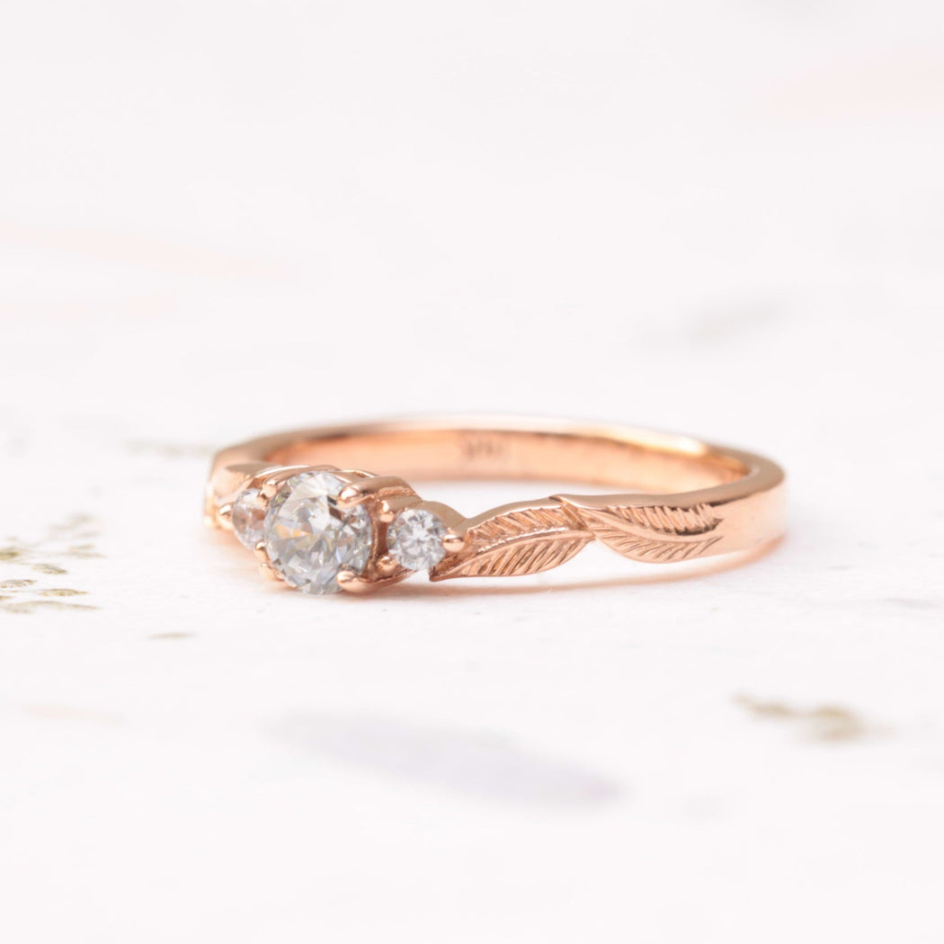 three diamond leaf engagement ring
