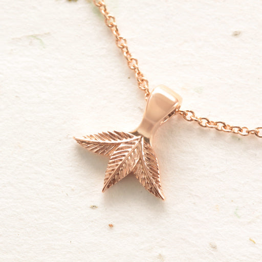 gold three leaf pendant