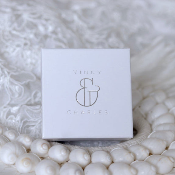 white vinnyandcharles ring box with silver logo
