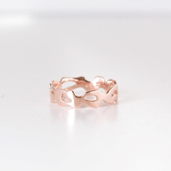 rose gold monstera ring on white background