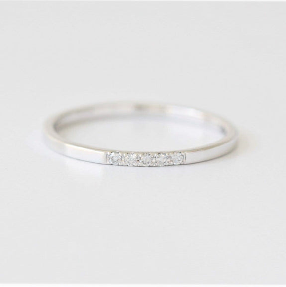 white gold diamond ring on white background
