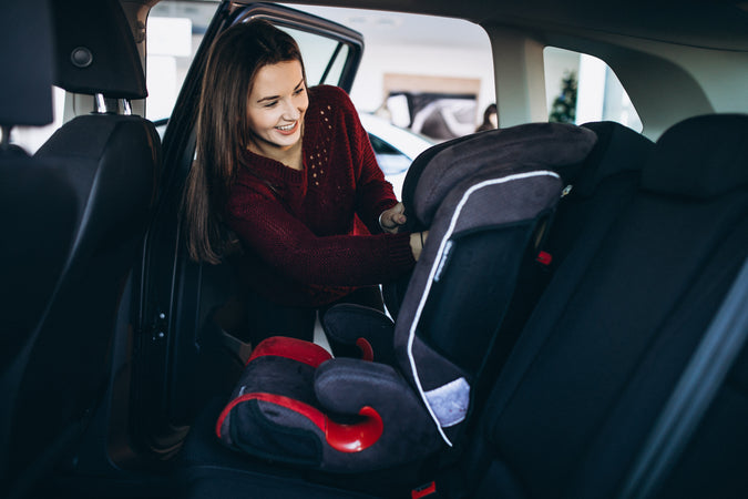 woman and the baby car seat