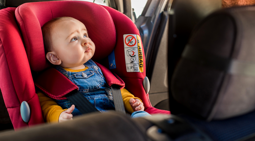 What are the extended rear-facing car seats available for my 13-month-old twins?