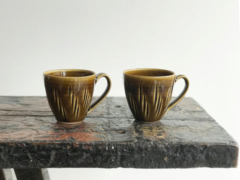 Two small coffee cups