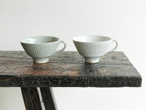 Two fluted stoneware cups