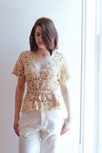 Travel in style in the beige crochet top by Alexis Corry | Lex & Zach - Go in Luxury