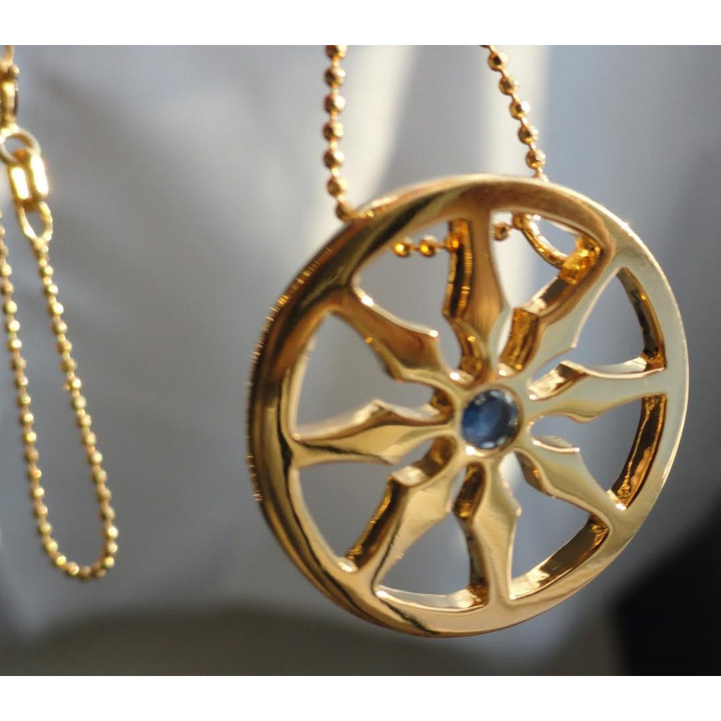 Dharma viii wheel single sapphire necklace goddaughters wearable spokes of the wheel symbolize the 8 noble truths of the eightfold path aloadofball Gallery