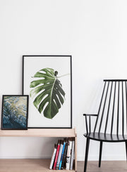 Minimalist art print by Opposite Wall with Scottish rocky cliffs aerial art photography - Living room with a black chair