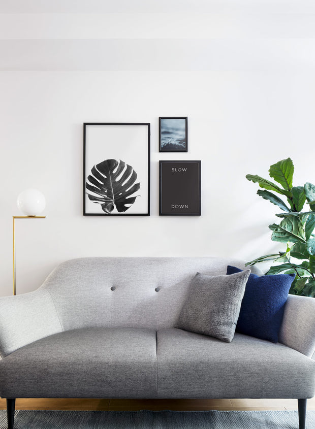 Scandinavian poster by Opposite Wall with graphic Slow _ Down typo design - Living room couch