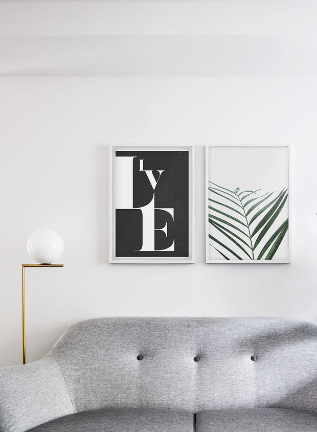 Minimalist botanical art poster by Opposite Wall with palm leaf Curves - Living room with a couch