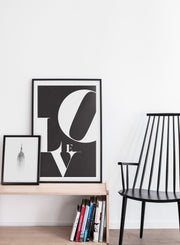 Scandinavian poster by Opposite Wall with trendy black and white Love typo design - Living room with a black chair