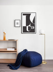 Scandinavian poster by Opposite Wall with trendy black and white typo design featuring the word LOUD - Living room with a pouf
