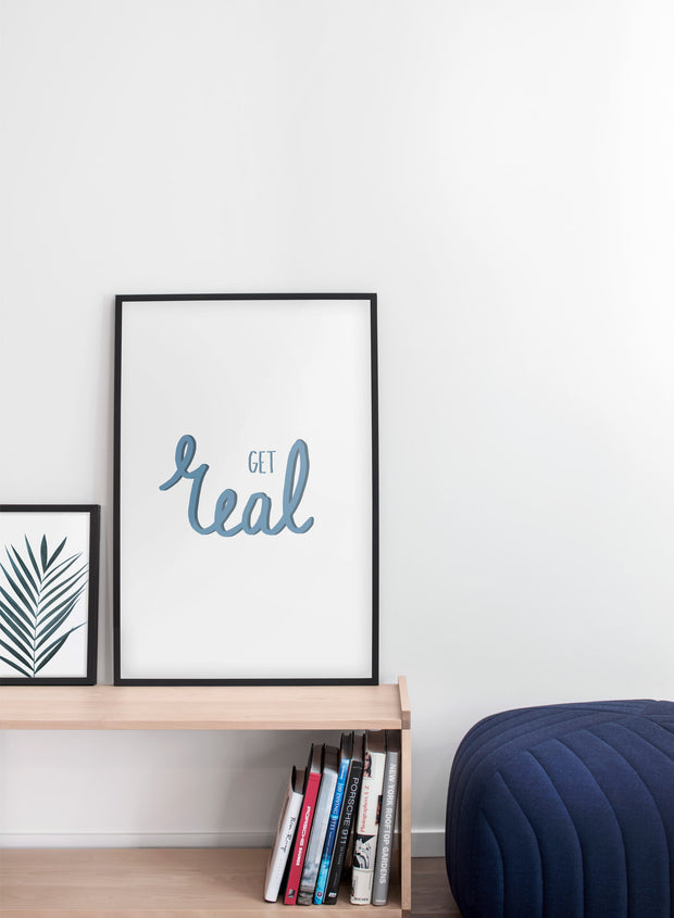 Scandinavian art print by Opposite Wall with trendy Get Real blue typography design - Living room with a pouf