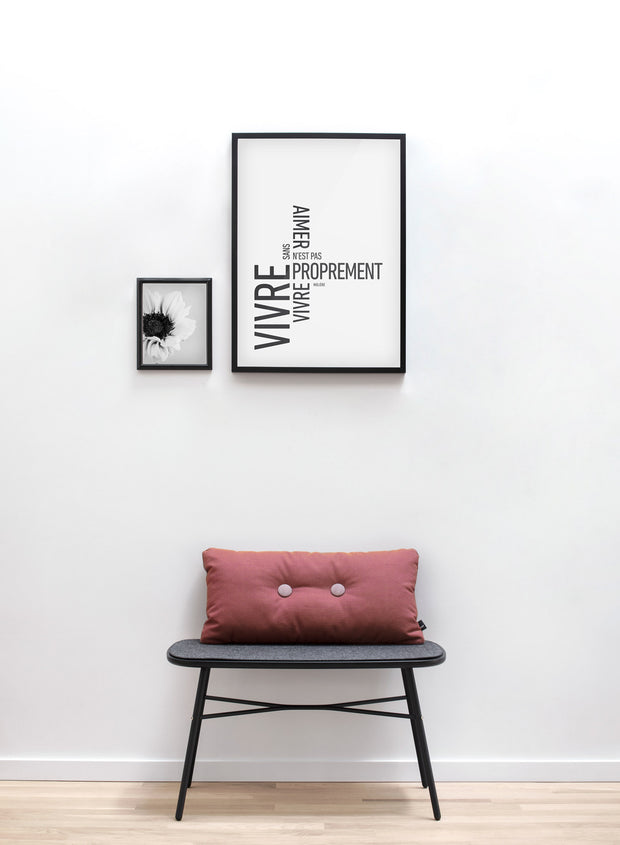 Scandinavian art print by Opposite Wall with modern black and white Loving graphic typography design - with Molière quote - Living room with a rasberry cushion