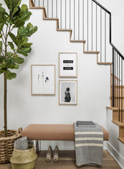 Scandinavian poster by Opposite Wall with black and white graphic typography design of Never for Ever - Hallway with a gallery wall trio