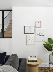Scandinavian poster by Opposite Wall with black and white graphic typography design of Take my to Paris - Living room with gallery wall quadruple