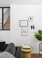 Scandinavian poster by Opposite Wall with black and white graphic typography design of Très Chic - Living room with gallery wall