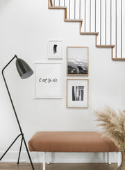 Scandinavian poster by Opposite Wall with black and white graphic typography design of C'est la vie - Hallway with staircase - gallery wall
