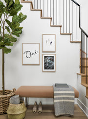 Scandinavian poster by Opposite Wall with black and white graphic typography design of Oui - Hallway with gallery wall trio