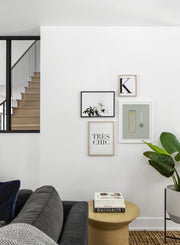 Scandinavian poster by Opposite Wall with black and white graphic typography design of the letter K - Living room with a staircase - Gallery Wall quadruple