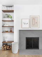 Scandinavian poster by Opposite Wall with black and white graphic typography design of this is art - Living room with a fireplace