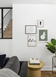 Scandinavian poster by Opposite Wall with black and white graphic typography design of Libre - Living room with a gallery wall quadruple