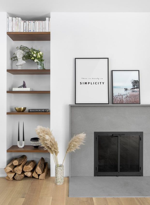 Scandinavian poster by Opposite Wall with black and white graphic typography design of Beauty in simplicity - Living room with a fireplace - duo