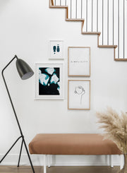 Scandinavian poster by Opposite Wall with black and white graphic typography design of Simplicity - Hallway with gallery wall quadruple