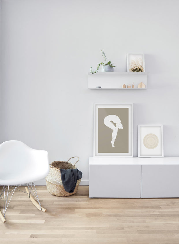 Modern minimalist poster by Opposite Wall with abstract illustration of a woman bending forward on pointe in white - Living room