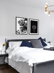 Modern minimalist poster by Opposite Wall with black and white Monstera still life botanical photography called Wild Ways - Bedroom