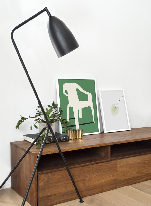 Modern minimalist poster by Opposite Wall with abstract collage illustration of plastic garden chair green background - Duo - Living room