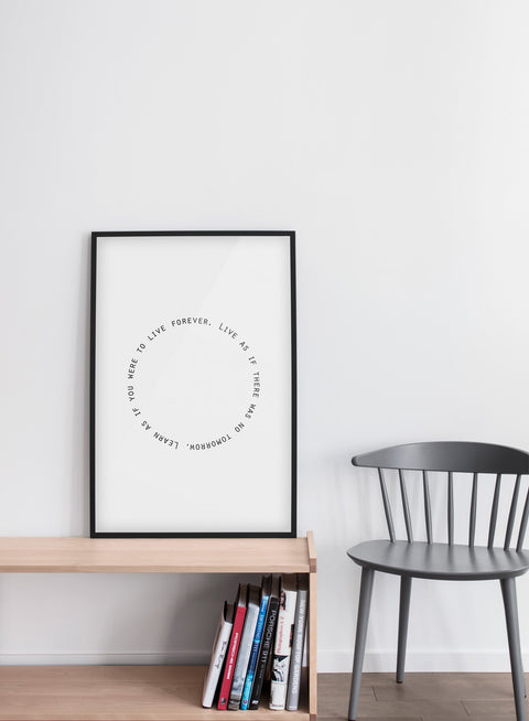 Modern minimalist poster by Opposite Wall with trendy round black and white Live and Learn typo design - Living room with a grey chair