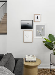 Minimalist poster quad featuring floral photography of white calla lily flower - Living Room