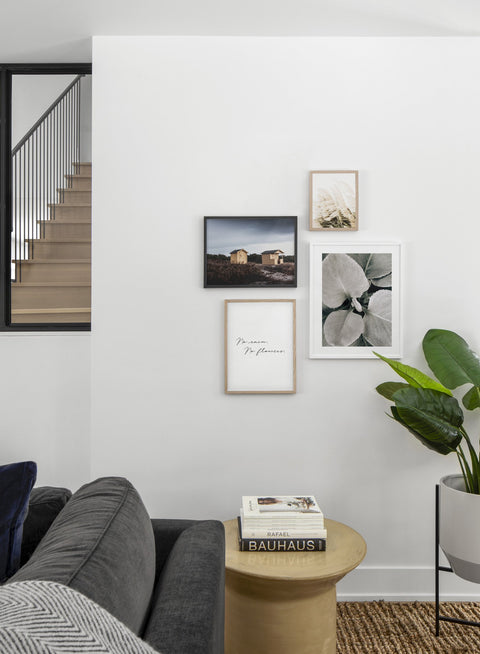 Minimalist poster quad featuring botanical photography of dusted leaves - Living Room
