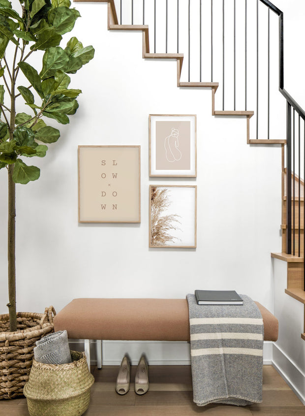Modern minimalist poster by Opposite Wall with graphic typo Slow x Down design in beige - Trio - Entryway