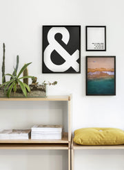 Scandinavian art print by Opposite Wall with trendy design of AND symbol - Living room close-up on a yellow cushion
