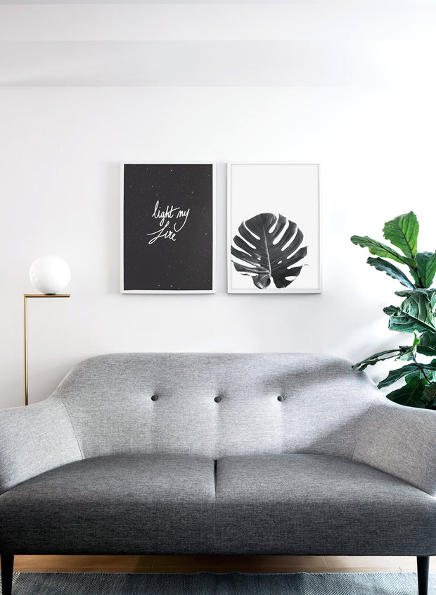 Scandinavian poster by Opposite Wall with trendy monstera leaf black and white art photo - Living room with a design lamp and sofa