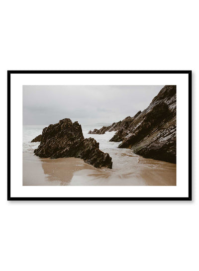 'Irish Boulders' is a landscape photography poster by Opposite Wall of tall rock boulders on a cloudy and peaceful beach in Ireland.