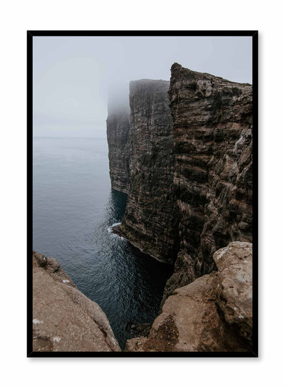 'Steep' is a landscape photography poster by Opposite Wall of a rocky cliff overlooking a vast body of water and bathing in cloudy mist.