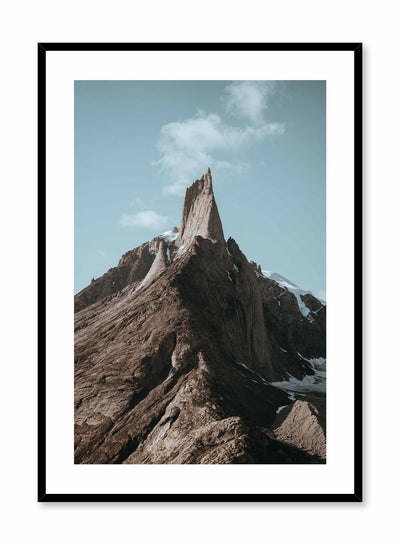 'Pinnacle' is landscape photography poster by Opposite Wall of the peak of a tall and snowy rocky mountain under a clear blue sky.