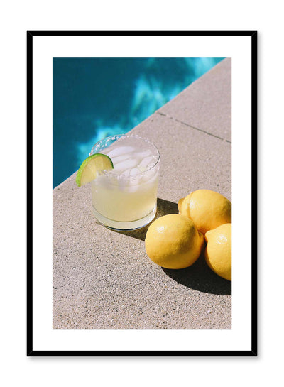 Summer Sip is a minimalist photography poster of a glass of cocktail next to lemons by Opposite Wall.