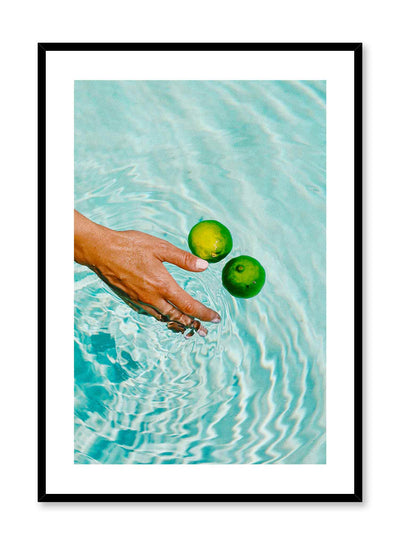 Zesty Pool is a minimalist photography poster of a hand pushing two limes in a pool by Opposite Wall.