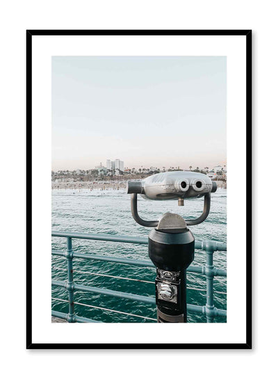 Beachside Binoculars is a relaxing photography poster of binoculars pointing a seashore landscape by Opposite Wall.